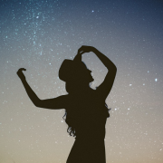 A woman has a sexual side, silhouetted woman agains the night sky